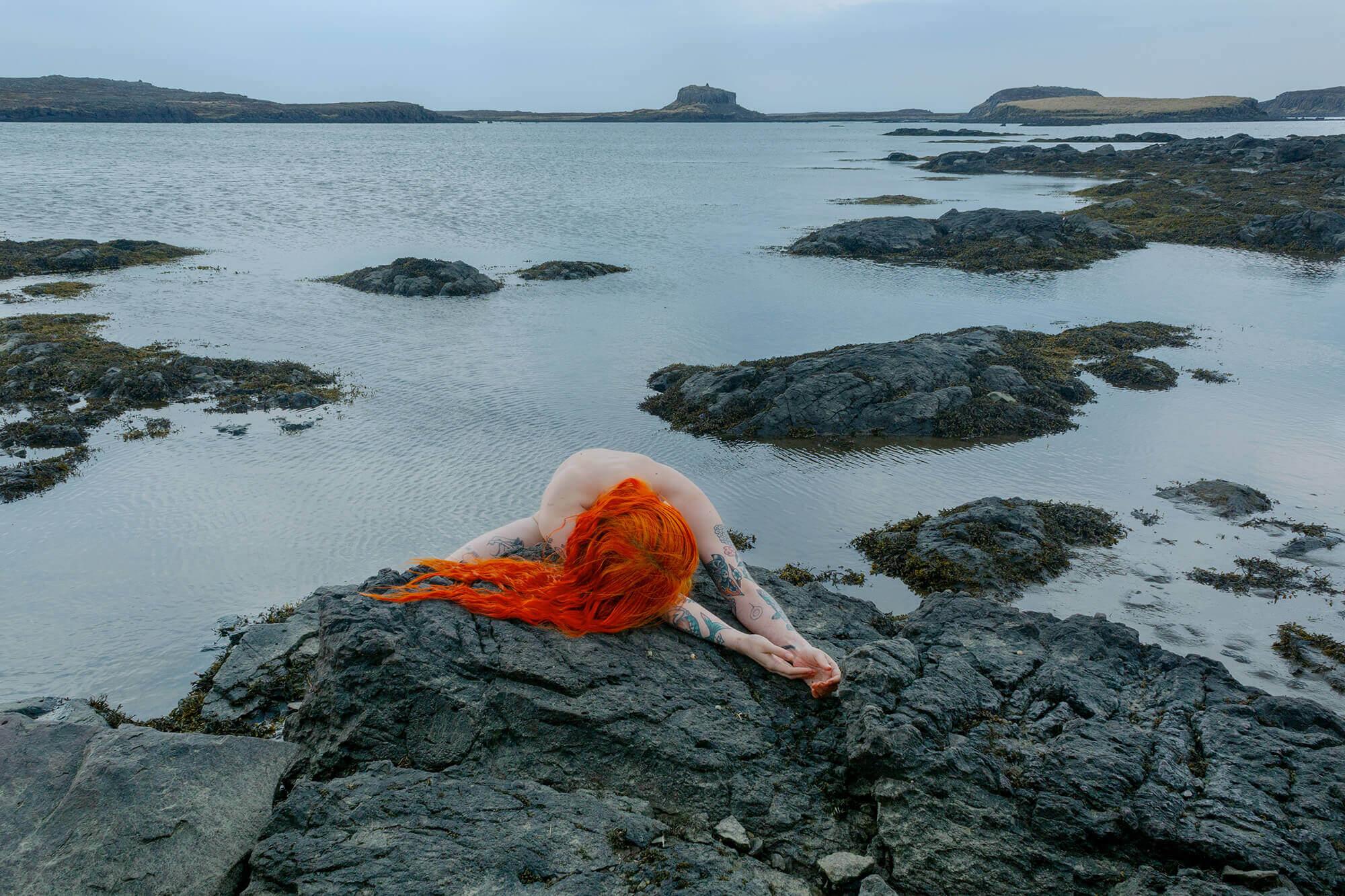 Lot#29<br />Self Portrait on Black Rocks, Huldufólk, Iceland ~ Laurence Philomene
